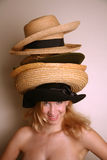 Western girl wearing many hats Royalty Free Stock Images
