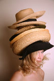 Western girl wearing many hats Stock Photo