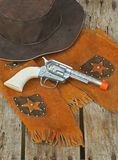 Western hat, vest, & toy gun. Stock Images