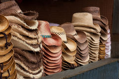 Western Hats on Display. Stacks of western hats on a dark background Stock Image
