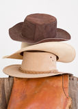 Western hats stacked on fence Royalty Free Stock Photos