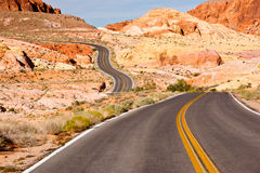 Western Highway. A long and winding road through colorful desert sandstone stock photos