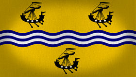 Western Isles Council flag. Flag whit some waves in blue and white in the center and three small ships, two in the superior side and one in the bottom, all over Royalty Free Stock Photography