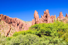 Western-like landscape with red rock formations in dry Quebrada de Palmira near Tupiza, Bolivian Andes, South America Stock Images