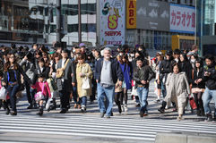 A western man surrounded by Japanese people Stock Photo