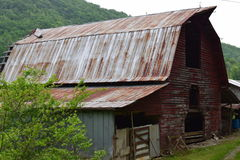 Western NC mountain old rural farm barn. With old metal roof Stock Image