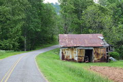Western NC mountain rural fam road. Passing a barn stock photography