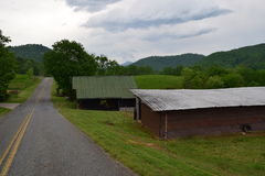 Western NC mountain rural road and barns. Western NC mountain rural farm road and barns royalty free stock photo