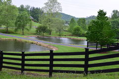 Western NC rural country mountain farmhouse. Western NC rural country mountain farm fenced with a house on a hill stock images