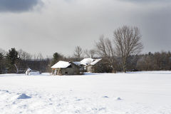 Western New York Winter. Snow covered, abandoned farm buildings in a wintery Western New York landscape Stock Image