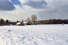Western New York Winter. Snow covered, abandoned farm buildings in a wintery Westeron New York landscape Stock Photo