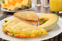 Western omelet with cantaloupe Stock Photo
