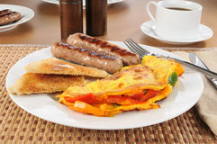 Western omlet with sausage. A western omelet with sausage and toast Royalty Free Stock Images