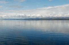 Lake Lama with a chain of mountains. Royalty Free Stock Photo