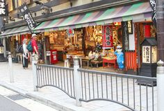 June 2018, Tourist couple shopping street colorful souvenir store, Kyoto, Japan royalty free stock image