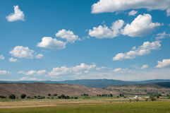 Western Ranch. Ranch near Eckert, Colorado with low horizon line and summer clouds Stock Image