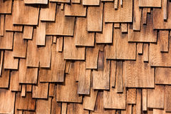 Western red cedar shingles unregular pattern. Unregular pattern of overlapping Western Red Cedar shingles natural organic wooden wall siding for residential Royalty Free Stock Photos