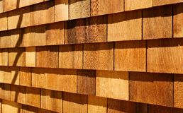 Western red cedar wood shingles wall siding. Western red cedar wood shingles (Blue Label - air dried) installed on wall with light oil based stain finish - hand Stock Photos