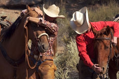 Western relationshi. Western couple taking a break from trail riding royalty free stock photos