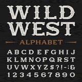 Western retro dirty alphabet vector font. Western style retro distressed alphabet vector font. Serif type dirty letters, numbers and symbols on a dark wood Stock Photography
