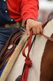 Western Riding. Detail of Western Riding Equipment: Hand with reins Royalty Free Stock Images