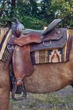 Western saddle for a horse. Decorated with beautiful ornament Royalty Free Stock Photos