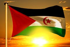 Western Sahara flag weaving on the beautiful orange sunset with clouds background. Western Sahara flag weaving on the beautiful orange sunset background Stock Photo