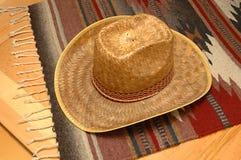 Western Scene. Cowboy Hat on Southwestern motif rug stock photos