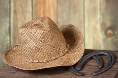 Western scene with cowboy hat and horseshoes Royalty Free Stock Photography