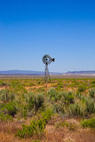 Western Scene with Old Windmill Royalty Free Stock Photography