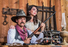Western Sheriff Poses With Woman. Western Sheriff Poses With a Woman stock images