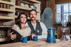 Western Sheriff and Woman Pose Inside House Stock Image
