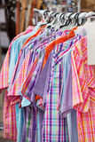 Western Shirts. A rack of ladies Western shirts for sale at the Calgary Stampede Stock Photos