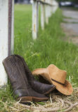 Western shoes and cowboy hat on ranch Royalty Free Stock Images