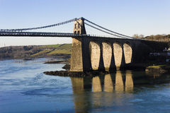 Western-side of the Menai Suspension Bridge & Menai Strait, Anglesey, North Wales Stock Photos