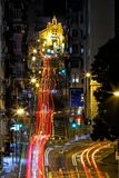 Light tracks in the high density city. Western Street, Hong Kong - December 26, 2018 : Light tracks in the high density city. Western Street is an uphill one-way royalty free stock photography