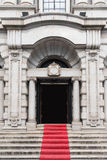 Western Style Government Building Gate With Red Ca. Rpet, Retro Style Royalty Free Stock Photos