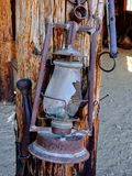 Western style rusty antique broken oil lantern hanging at farm countryside old lamp vintage style hang on wood background. Arizona, USA Stock Photography