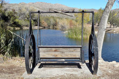 Western Swing overlooking lake in Tucson. Western swing overlooking lake near Tucson Stock Photo