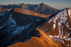 Western Tatras at sunset. Autumn sunset at the top in the Western Tatras, with High Tatras on the horizon Royalty Free Stock Photography