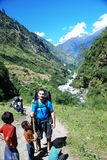 Western tourist with local Nepali kids Royalty Free Stock Photo