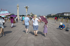 Western tourists in Tiananmen Square Stock Photo