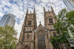 The Western Towers of Sydney`s St Andrew`s Cathedral against a dramatic sky, Australia. Oceania royalty free stock photo