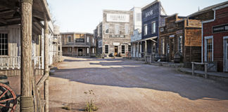Western town with various businesses . 3d rendering stock illustration