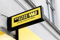 Western Union sign and logo on a facade. Aarhus, Denmark - July 15, 2017: Western Union sign and logo on a facade. The Western Union company is an american Stock Photography