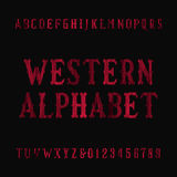 Western vintage alphabet font. Distressed serif letters and numbers. Stock Image