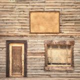 Western vintage wooden facade background. Door, window and blank board Stock Photos