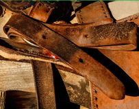 Western vintge saddle and cinch strap. Aged and worn in the heat of the dessert sun this saddle and cinch while showing all of the signs of age, also display the Royalty Free Stock Photos