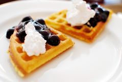 Western waffles with cream and berry toppings Royalty Free Stock Photo