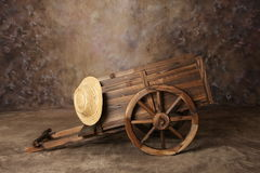 Western Wagon Cart. Studio Photograph of Wagon with Straw Hat royalty free stock photos